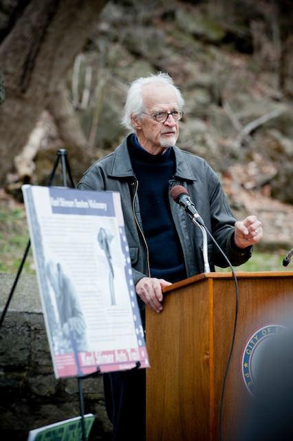 Karl Stirner speaks at the ribbon cutting for the Karl Stirner Arts Trail. Photo by Ken Ek.