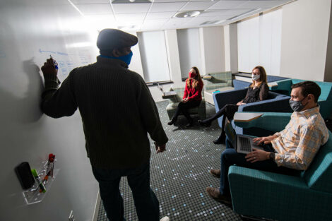 coworkers chatting in Alpha's Creative Lounge