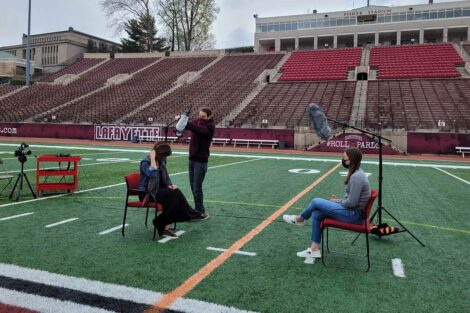 behind the scenes at a photo shoot at Fisher Stadium